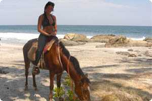 Horseback riding on the beach in Montezuma