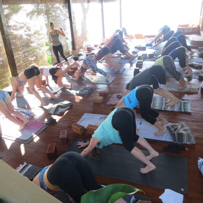 Anna teaching on Anamaya main yoga deck
