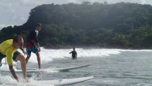 Beginners surfing class at Playa Grande