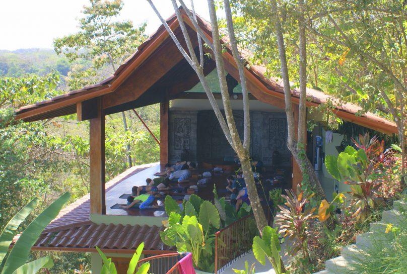 Yoga class on Acamaya lower deck