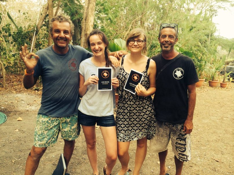 Dive Instructors Michele and David with Two Students