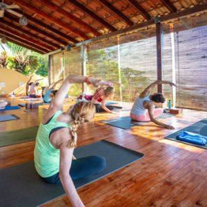 yoga on the deck at Anamaya