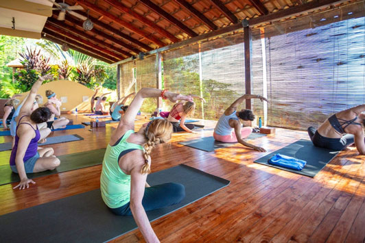yoga on the deck at Anamaya